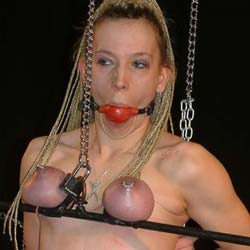 Ball gagging the slave  placing a ball gag in my slaves mouth while i ravage her hot tits really does turn me on. Placing a ball gag in my slaves mouth while I ravage her hot tits really does turn me on.
