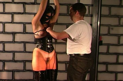Beginning the process 76. Slut is removed from the waiting post and begins to be tied up with rope