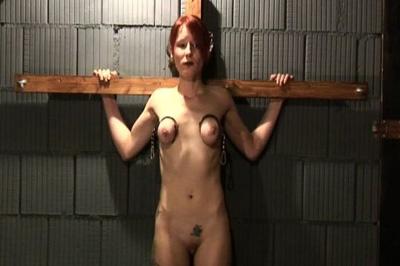 Her first insertion 23. After her arms are restrained behind her back, she's made to sit on a pole, have sex herself.