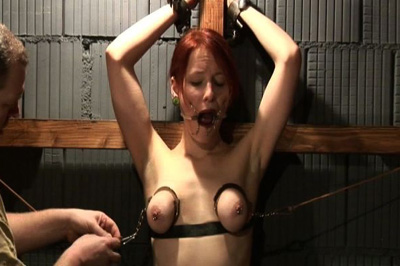 Flogging the whore 35. Her arms are put into bondage and then suspended from the ceiling. When in position, she has to gulp on a dildo while getting her vagina flogged.