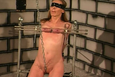No where to go 14  with her natural tits in a breast bondage vice this chick is tied up  complete with a chain through her cunt. With her tits in a breast bondage vice, this chick is tied up - complete with a chain through her pussy.