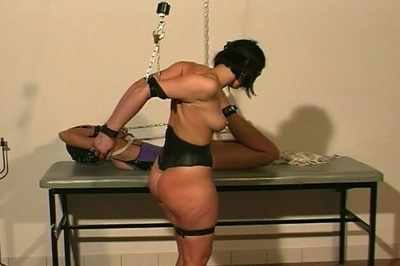 Preparations 44. One babe is hogtied and laid on a table while the other is prepared