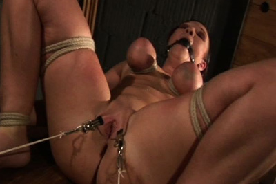 Continuing to restrain 25. Her arms and legs are tied down, her natural tits get even more torment, and then her cunt lips are spread open wide